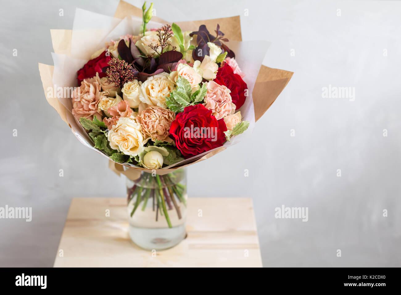 Bouquet in kraft paper a simple bouquet of flowers and greens stock bouquet in kraft paper a simple bouquet of flowers and greens izmirmasajfo