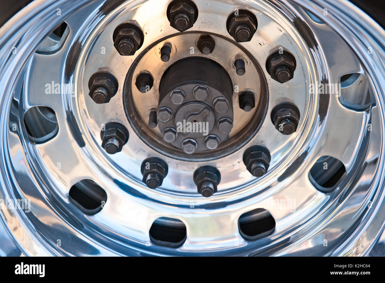 closeup view of a chrome plated modern sports or hotrod car double tire wheel