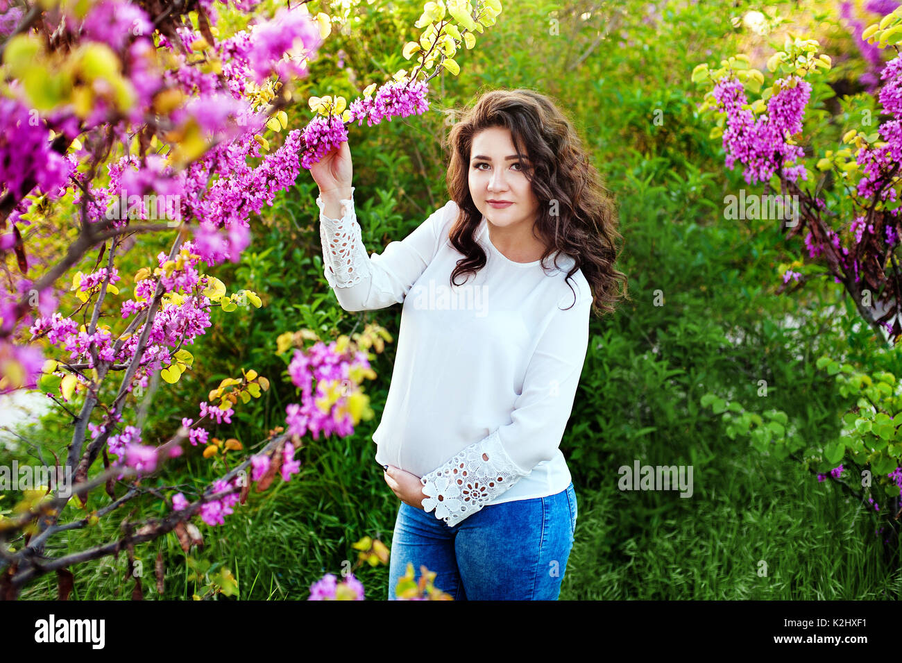 Beautiful pregnant woman in blooming stock photos for Gardening while pregnant