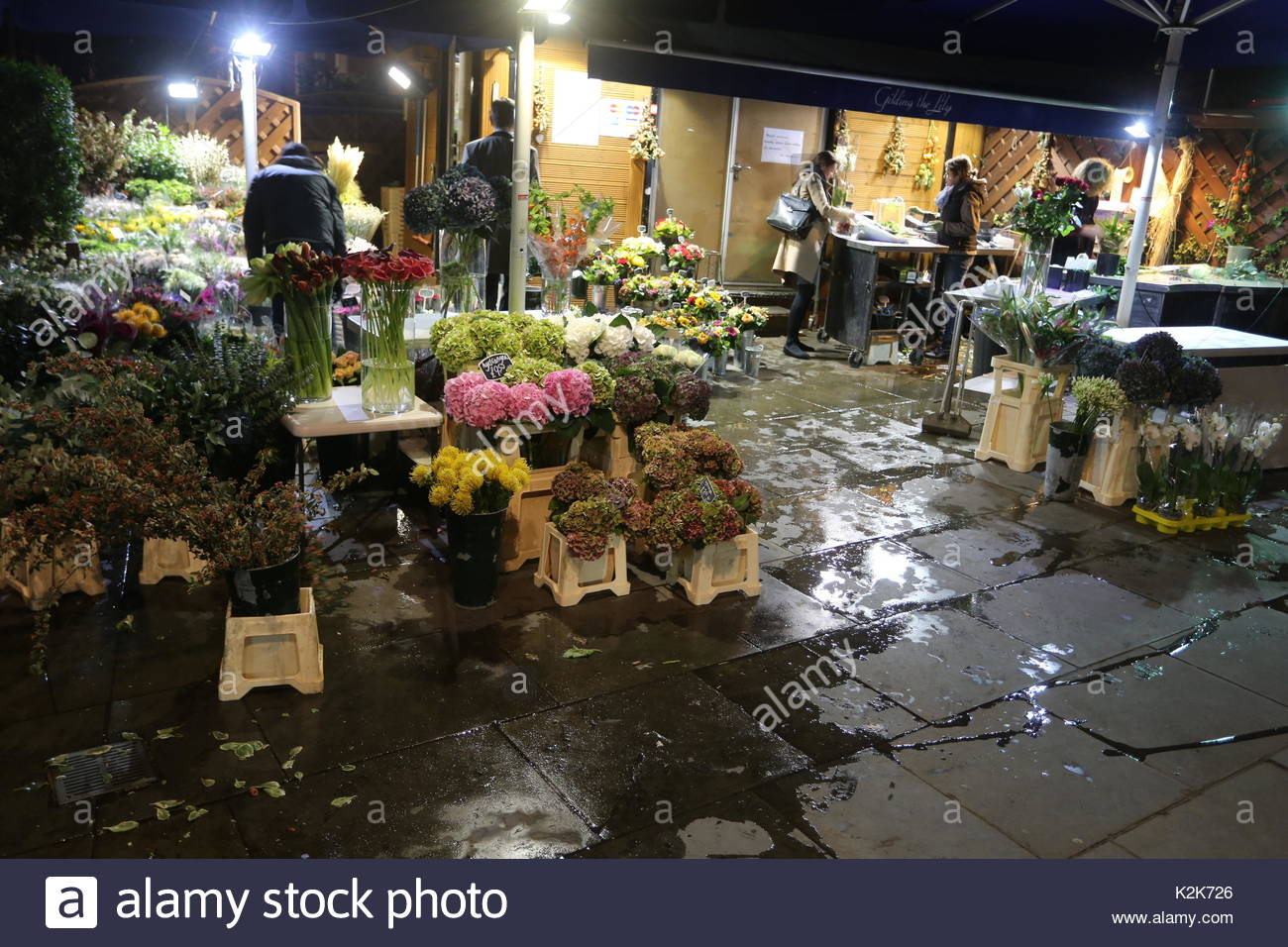 A display of flowers for sale at gilding the lily near the south a display of flowers for sale at gilding the lily near the south kensington tube station on october 13 2016 in london great britain united kingdom izmirmasajfo Image collections
