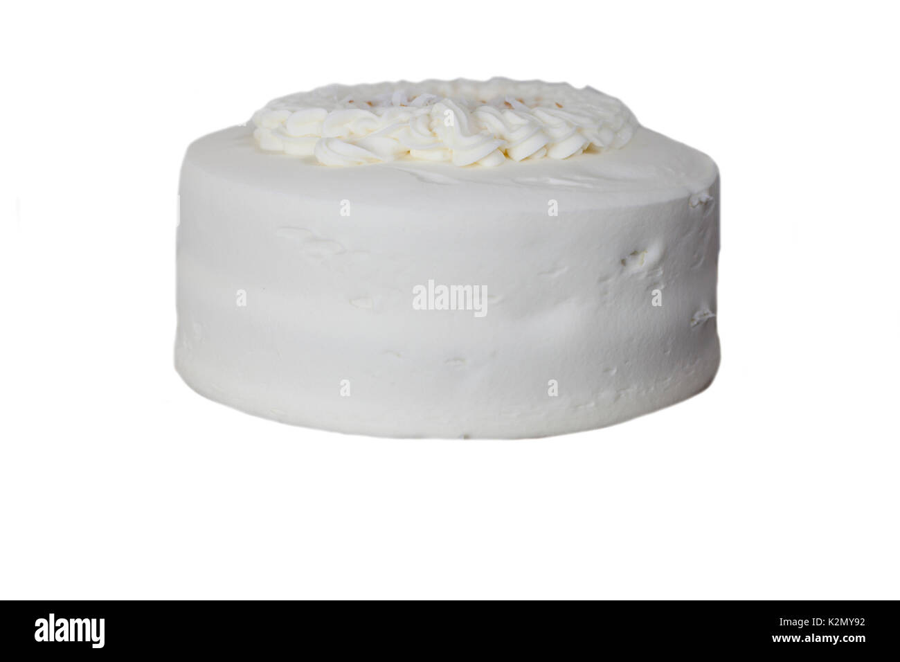 Isolated Uncut Italian Cream Cake With Delicious White Icing Stock