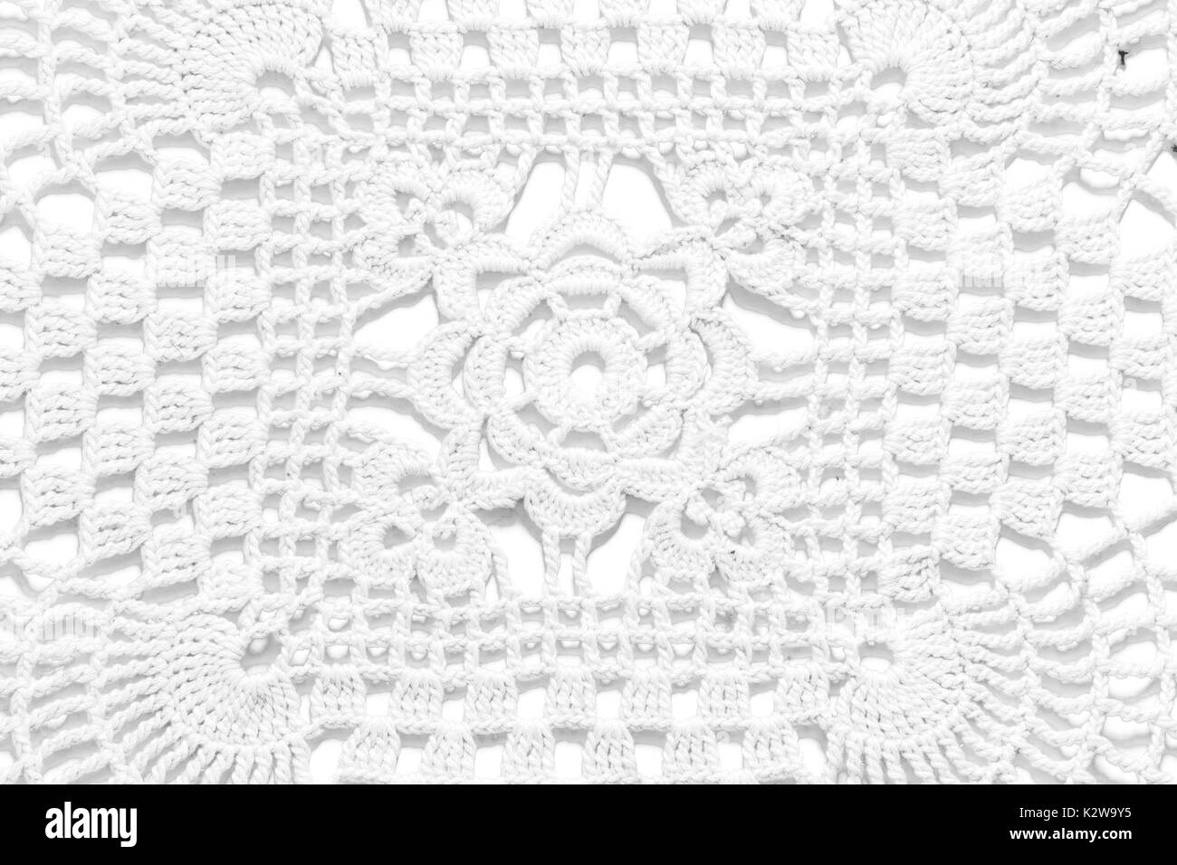 White Handmade Lace Tablecloth Texture On White Background.