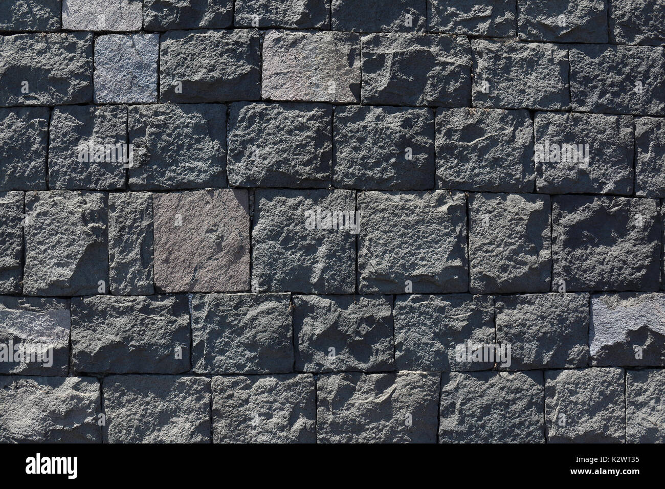 Black Basalt Stone Wall : Patterned wallpaper grey stock photos
