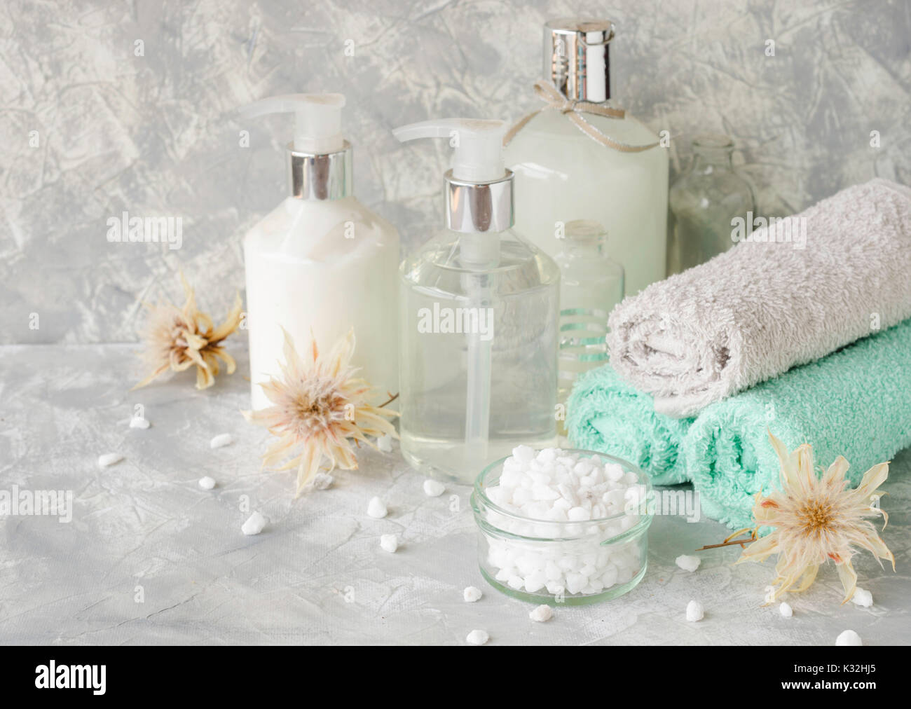 Spa set on a white marble table with a stack of towels, colors Stock ...