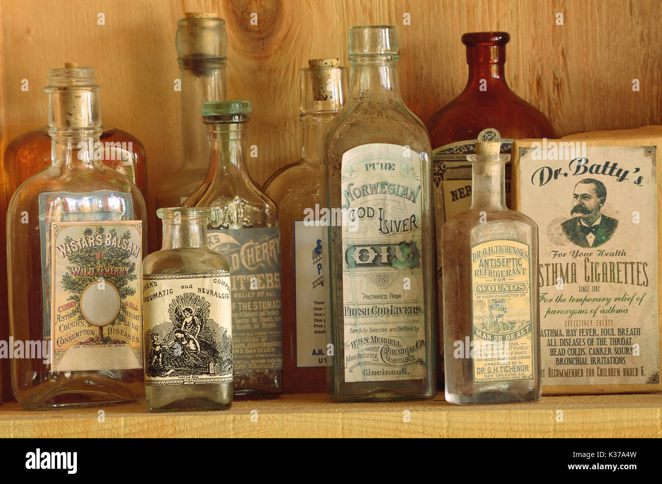 Antique medicine bottles with vintage labels with details about their  contents