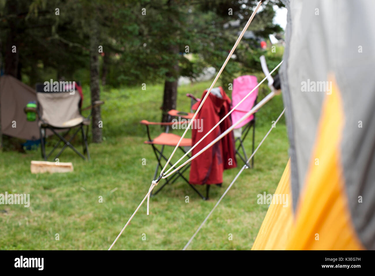 Close up of orange tent fabric or flap with forest behind - Stock Image & Open Tent Flap Stock Photos u0026 Open Tent Flap Stock Images - Alamy