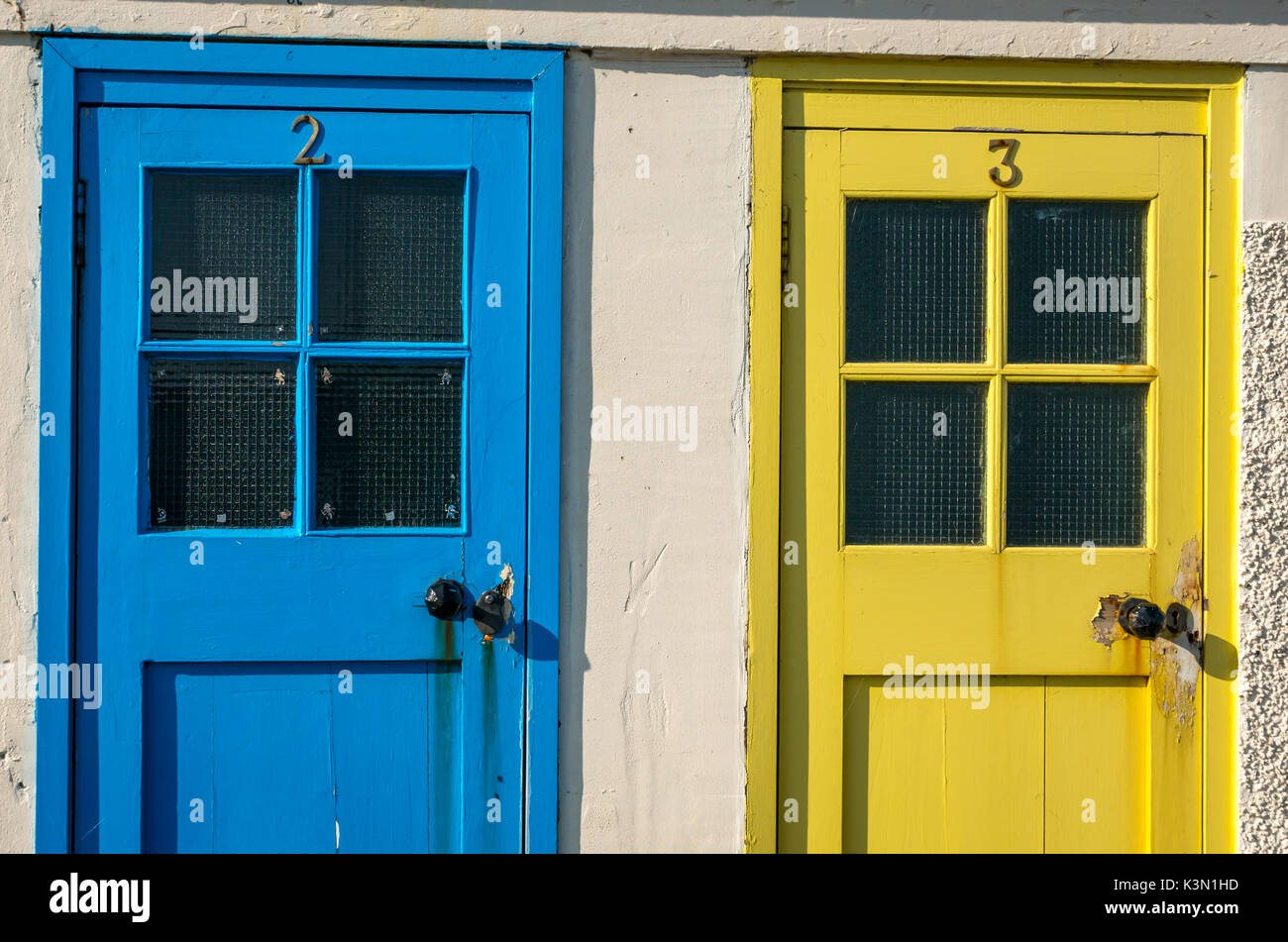 Close up of colourful blue and yellow old doors at North Berwick harbour East Lothian Scotland UK previously swimming pool changing cubicles & Close up of colourful blue and yellow old doors at North Berwick ...