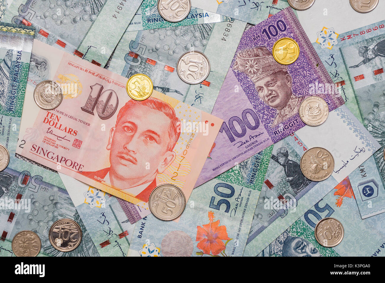 Singapore dollar and coins on top of malaysian ringgit currency on singapore dollar and coins on top of malaysian ringgit currency on pattern background malaysian ringgit symbol is rm currency code myr singapore dol biocorpaavc