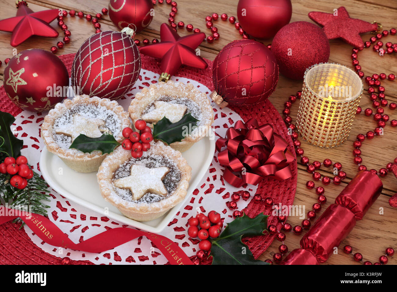 Why is holly a traditional christmas decoration - Traditional Christmas Iince Pies On A Heart Shaped Plate With Red Bauble Decorations And Holly With