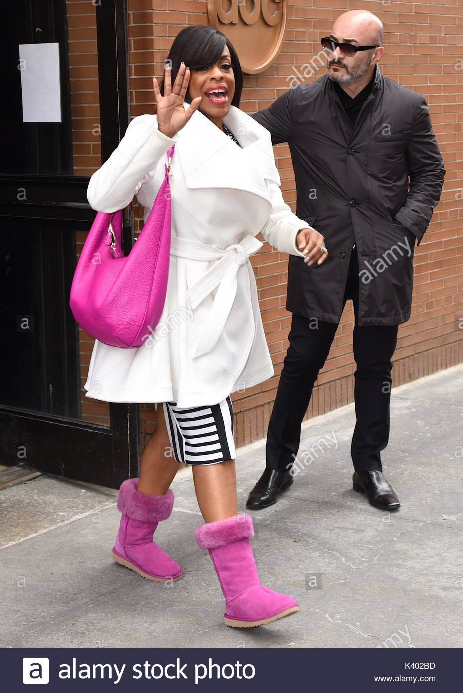 Niecy Nash seen leaving 'The View' in pink UGG boots and carrying a matching handbag today in NYC