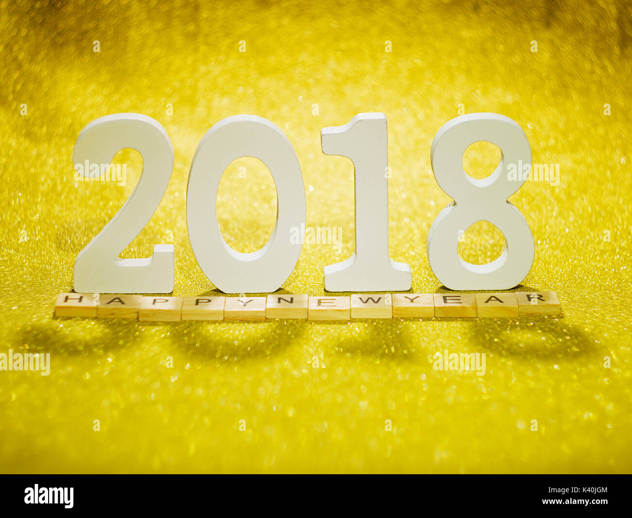 2018 wood letters on gold glitter table for 2018 new year background