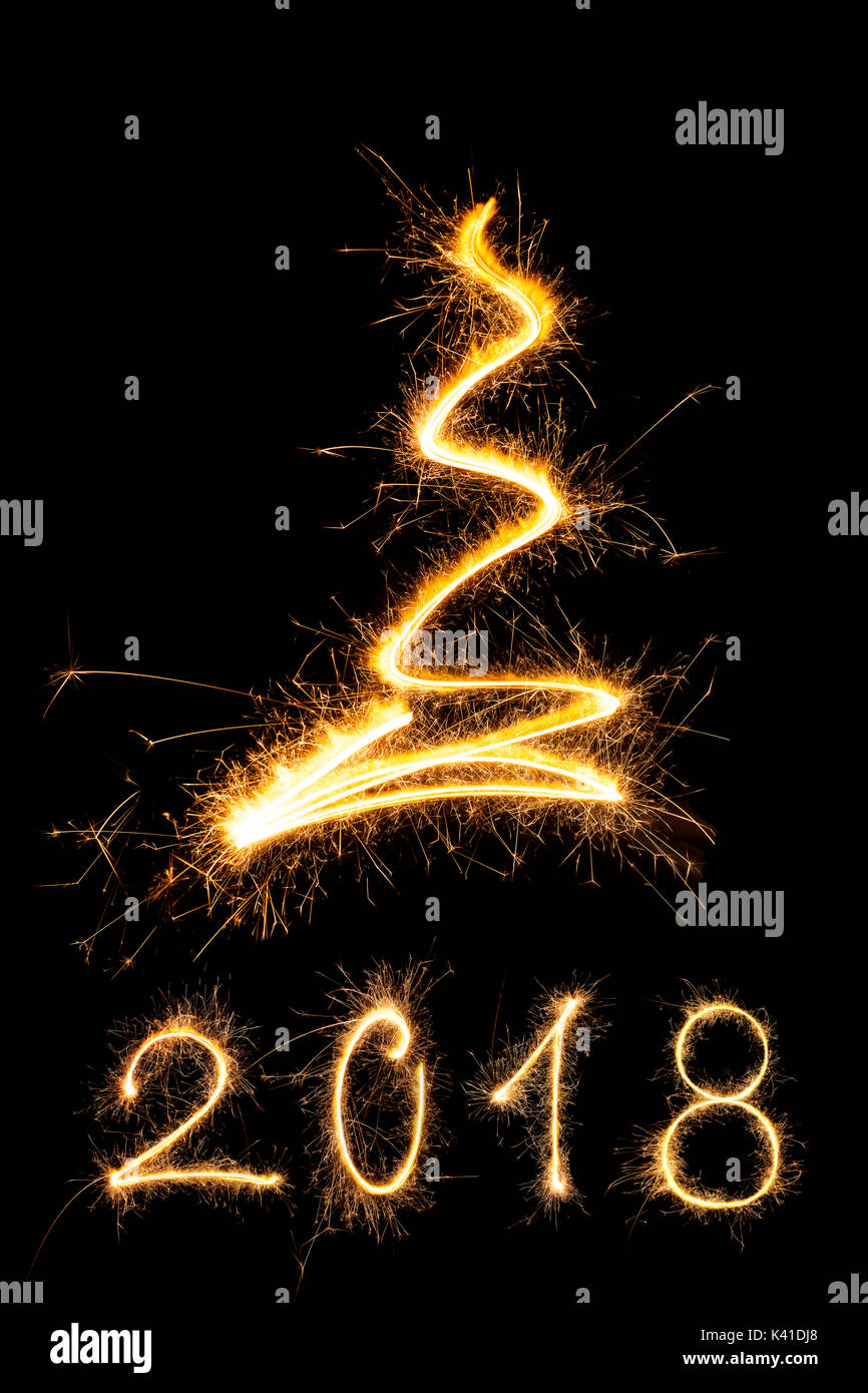 merry christmas and happy new year 2018 sparkling firework christmas and new year text on black background minimal abstract artistic style