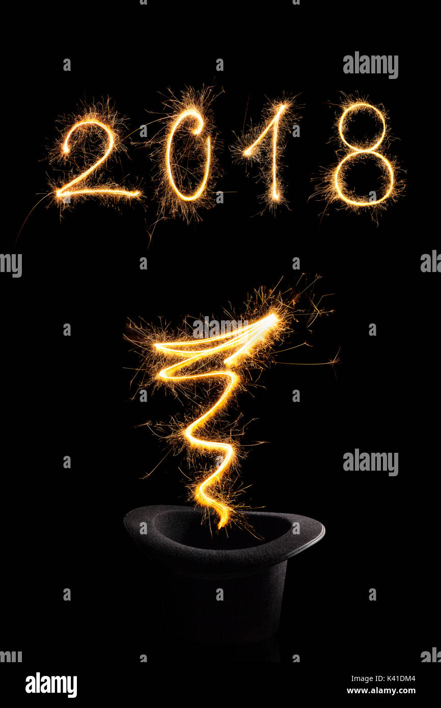 magical new year magical fireworks from black top hat forming 2018 and abstract light lines isolated on black background happy new year background