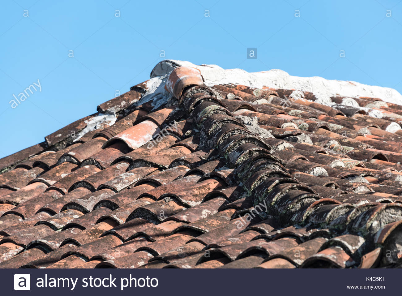 Ceramic terracotta tiles laid on a slanting roof the slightly ceramic terracotta tiles laid on a slanting roof the slightly raised center row blackened more than others dailygadgetfo Image collections