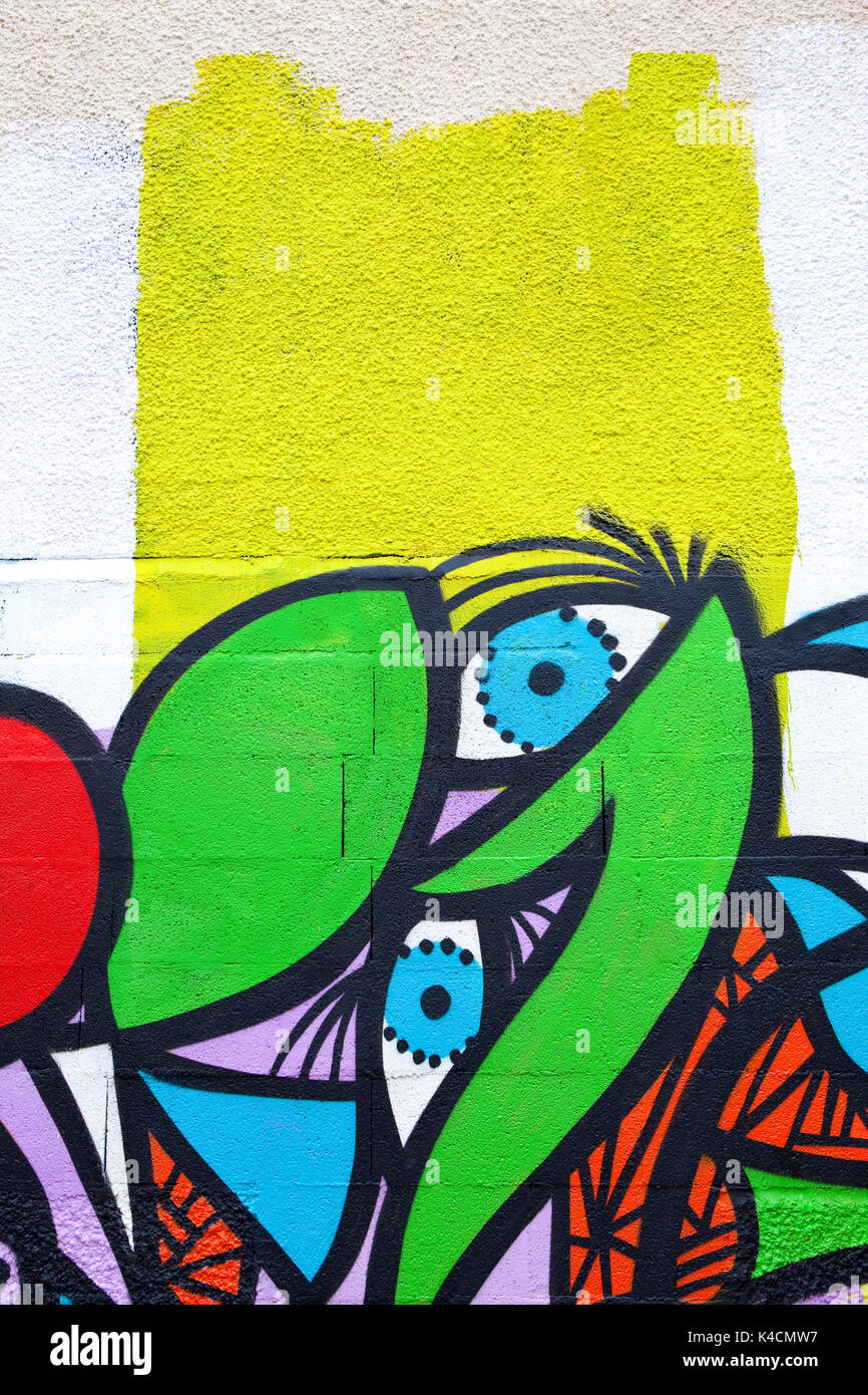 Detail of a colorful graffiti on a cinder blocks wall Stock Photo ...