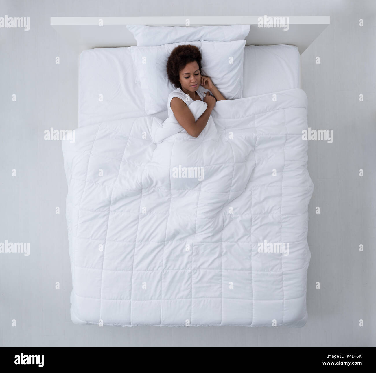 mattress top view. Beautiful African American Woman Lying In Bed And Sleeping, Top View Mattress
