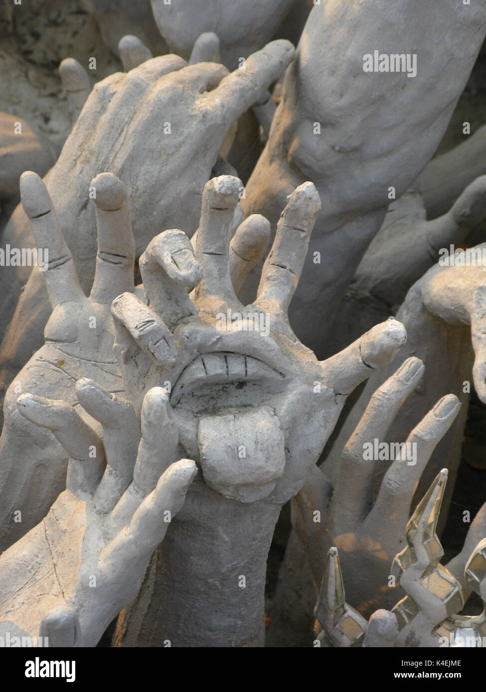 Beautiful and amazing wat rongkhun white temple the symbol of beautiful and amazing wat rongkhun white temple the symbol of the group rolling stones tongue on the hand among the sculptures of the temple biocorpaavc