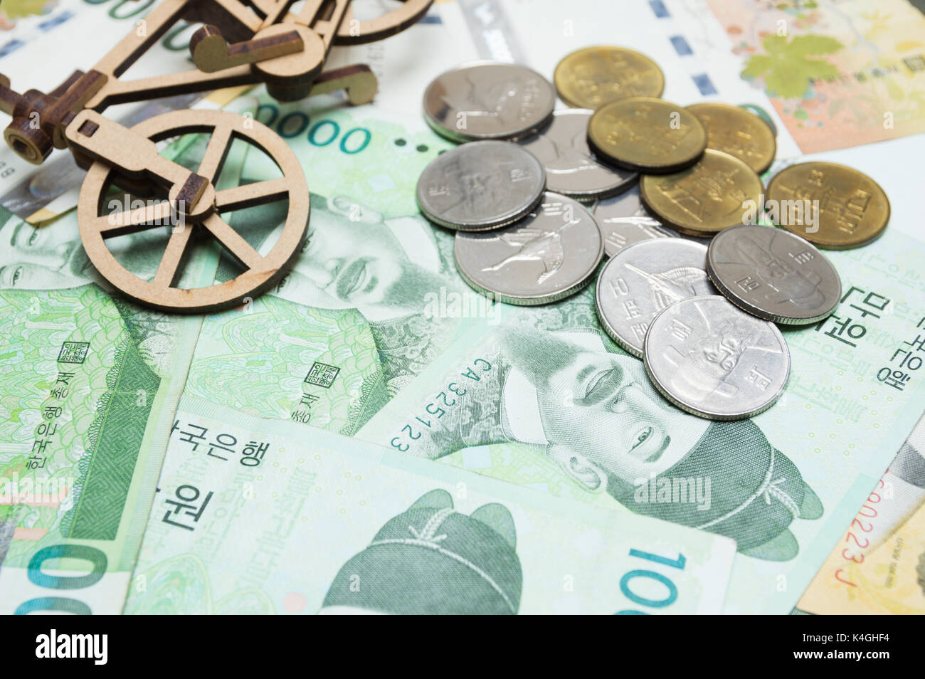Toy bicycle and coin on south korean won currency stock photo toy bicycle and coin on south korean won currency buycottarizona