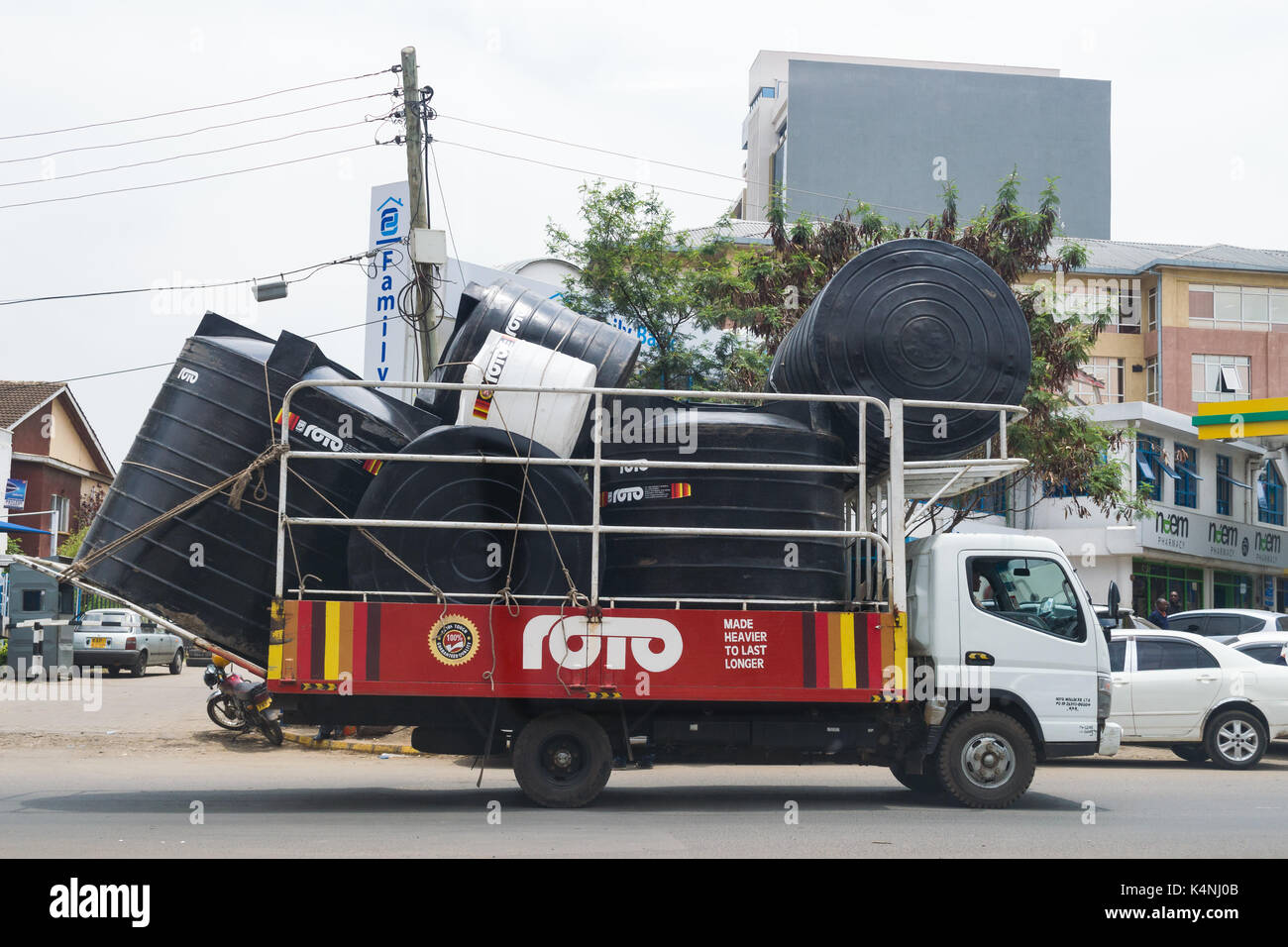 Truck carrying high capacity water tanks for delivery, Nairobi
