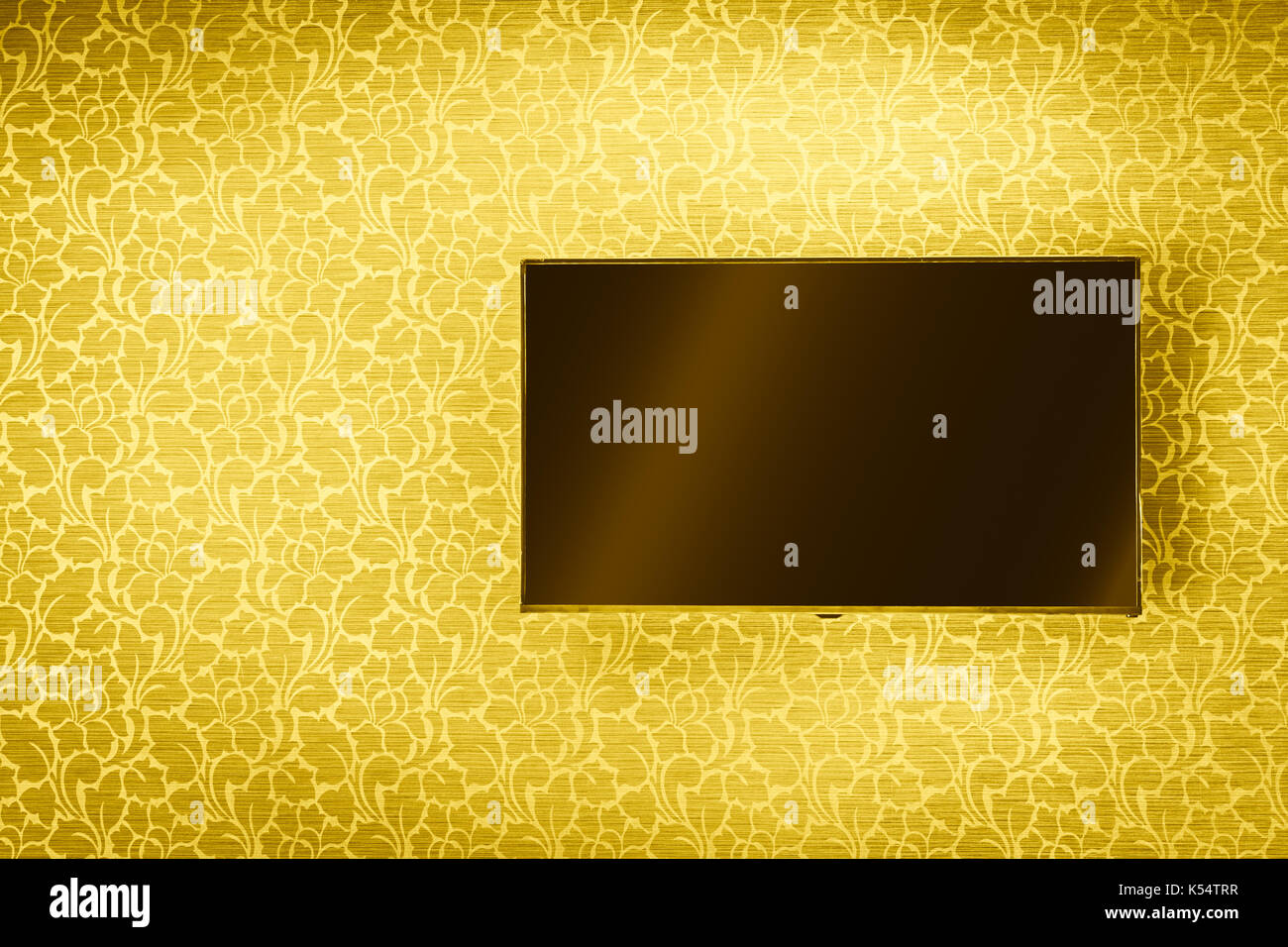 LCD TV Panel hanging on luxury golden wall background Stock Photo ...