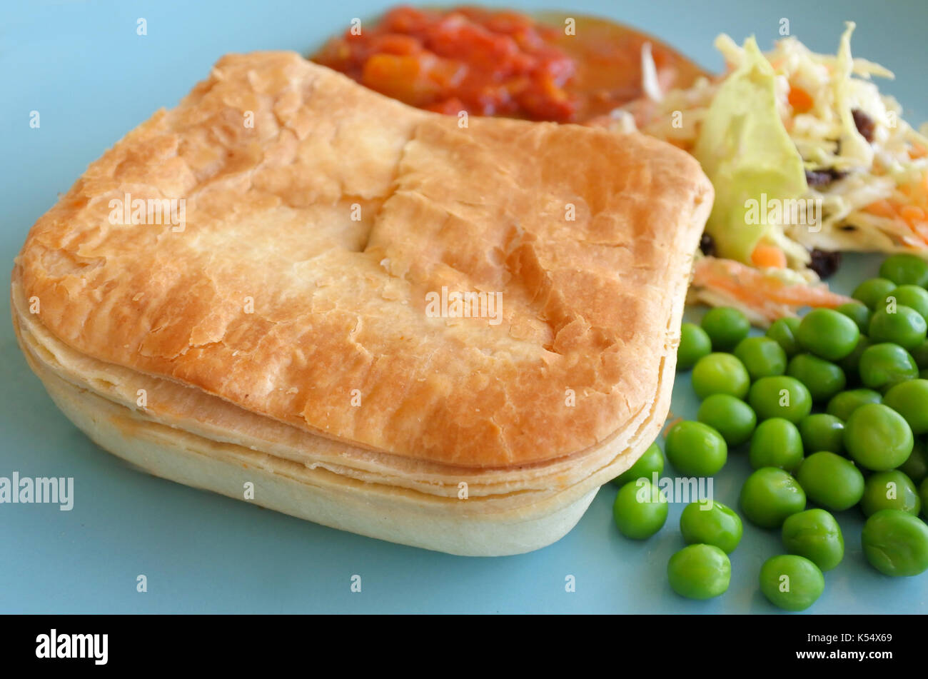 Mince meat pie served on a plate with pees coleslaw salad and tomato sauce. & New Zealand Beef Mince Stock Photos \u0026 New Zealand Beef Mince Stock ...
