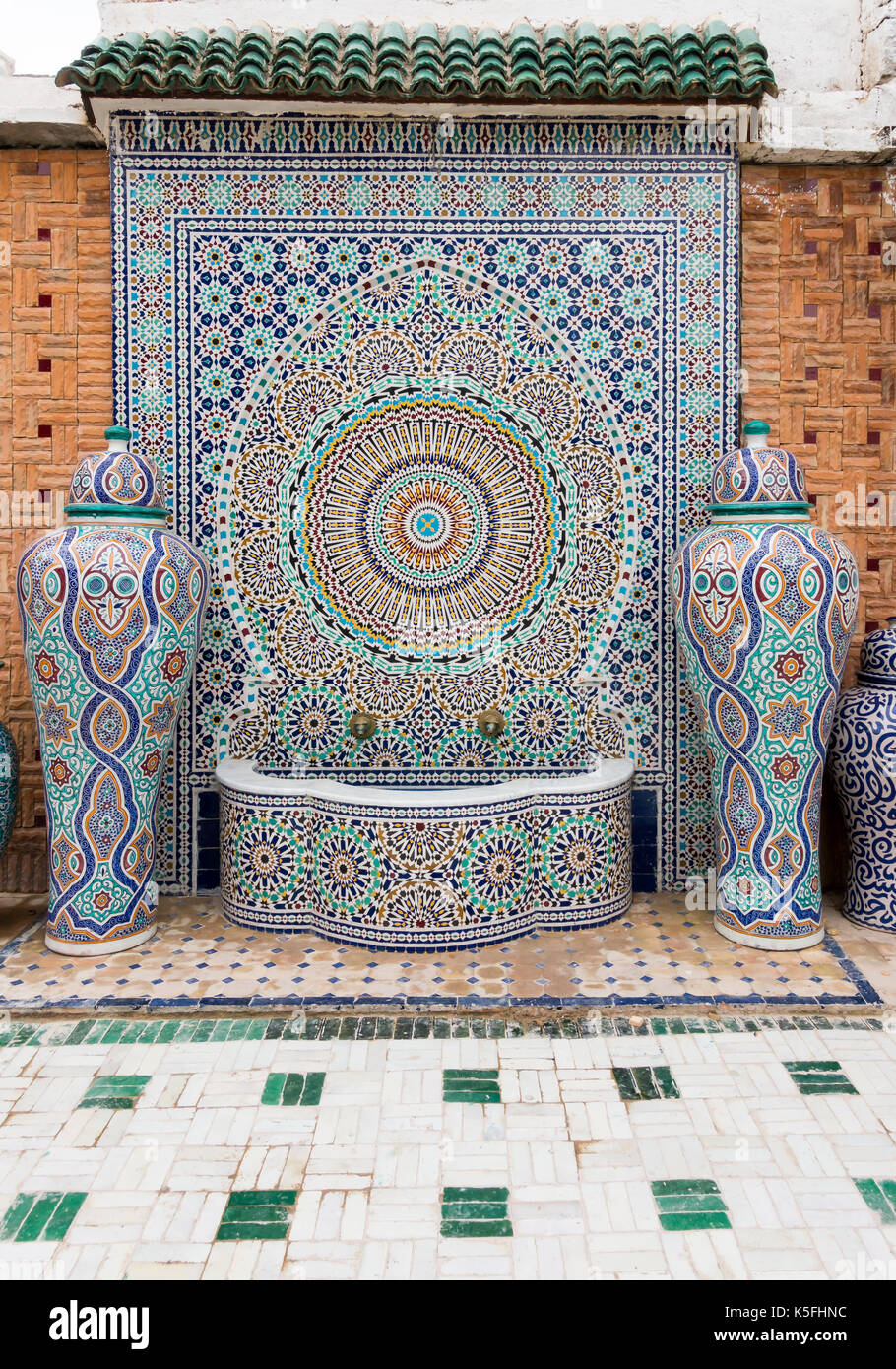 Moroccan vase stock photos moroccan vase stock images alamy fez morocco may 07 2017 typical handmade moroccan mosaic fountain and vases reviewsmspy