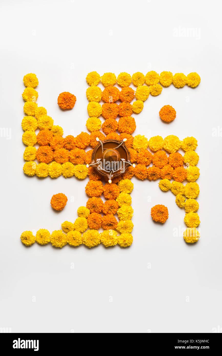 Hindu swastika stock photos hindu swastika stock images alamy stock photo of hindu auspicious symbol called swastika or swastik made using marigold flowerzendu biocorpaavc