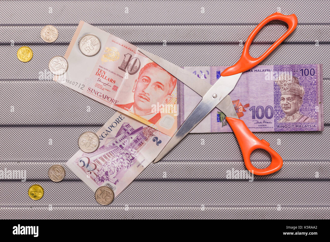 Singapore dollar and coins on top of malaysian ringgit currency on singapore dollar and coins on top of malaysian ringgit currency on pattern background concept currency exchanges money value cutting down malaysian buycottarizona Image collections