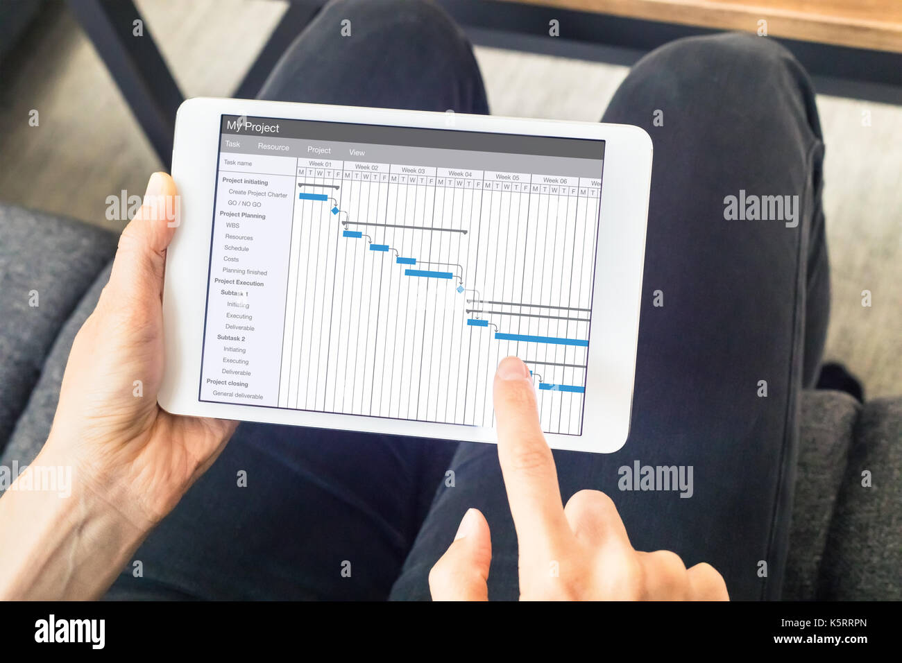 Gantt chart stock photos gantt chart stock images alamy project manager working with gantt chart with planning software on digital tablet computer to update the nvjuhfo Choice Image