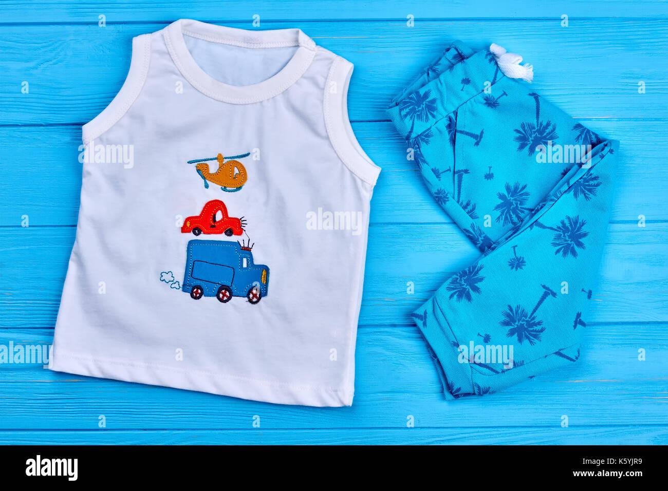Trendy set of baby boy apparel. Toddler boy white printed t-shirt ...