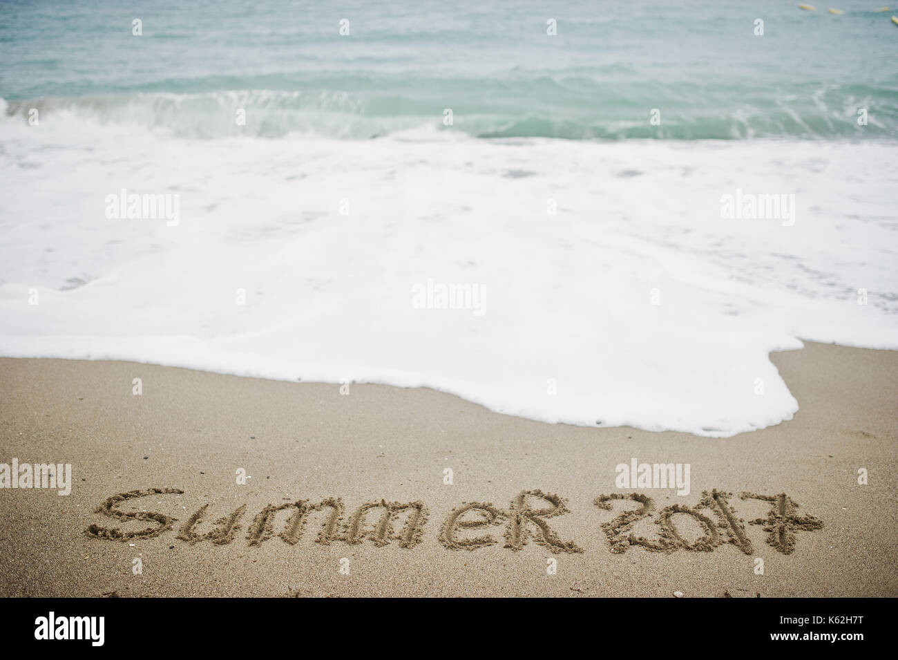 Summer 2017 End. New Year 2018 Is Coming Concept. Sea And Sand