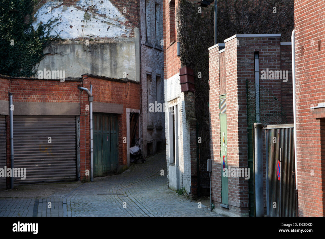 Garage Doors And A Small Dark Alley In A Residential District Of