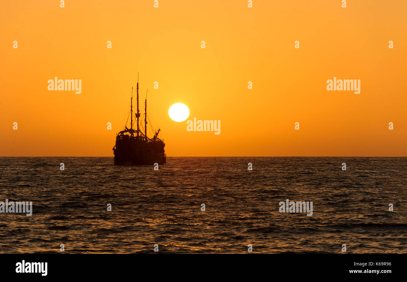 Ocean Sunset Ship Silhouette Is An Old Wooden Sitting At Sea Watching The On Horizon
