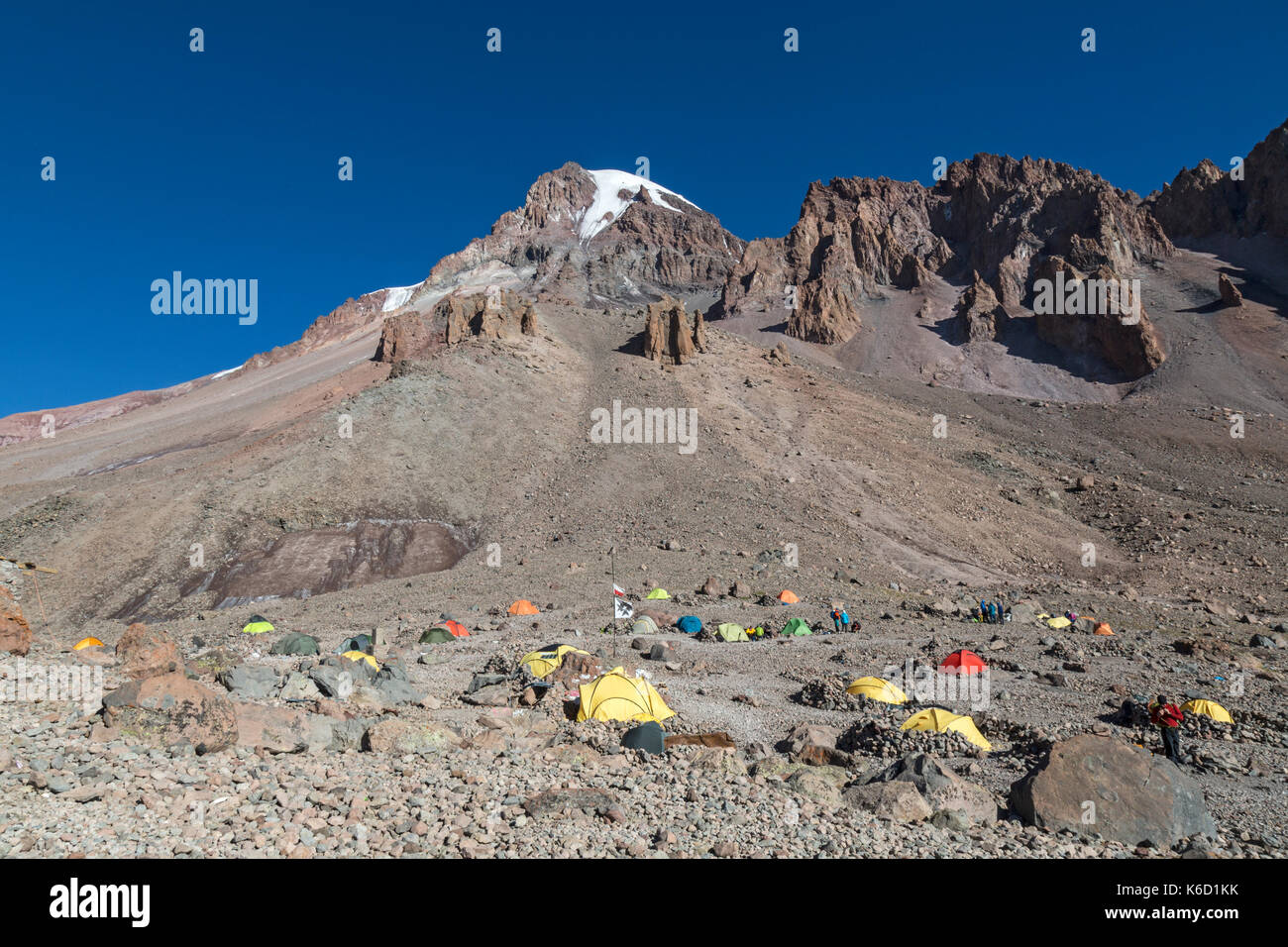 A large number of tents pitched below the summit of Mount Kazbek in Georgia. This is the base c& area beside the Betlemi Hut and is at 3653 metres & A large number of tents pitched below the summit of Mount Kazbek ...