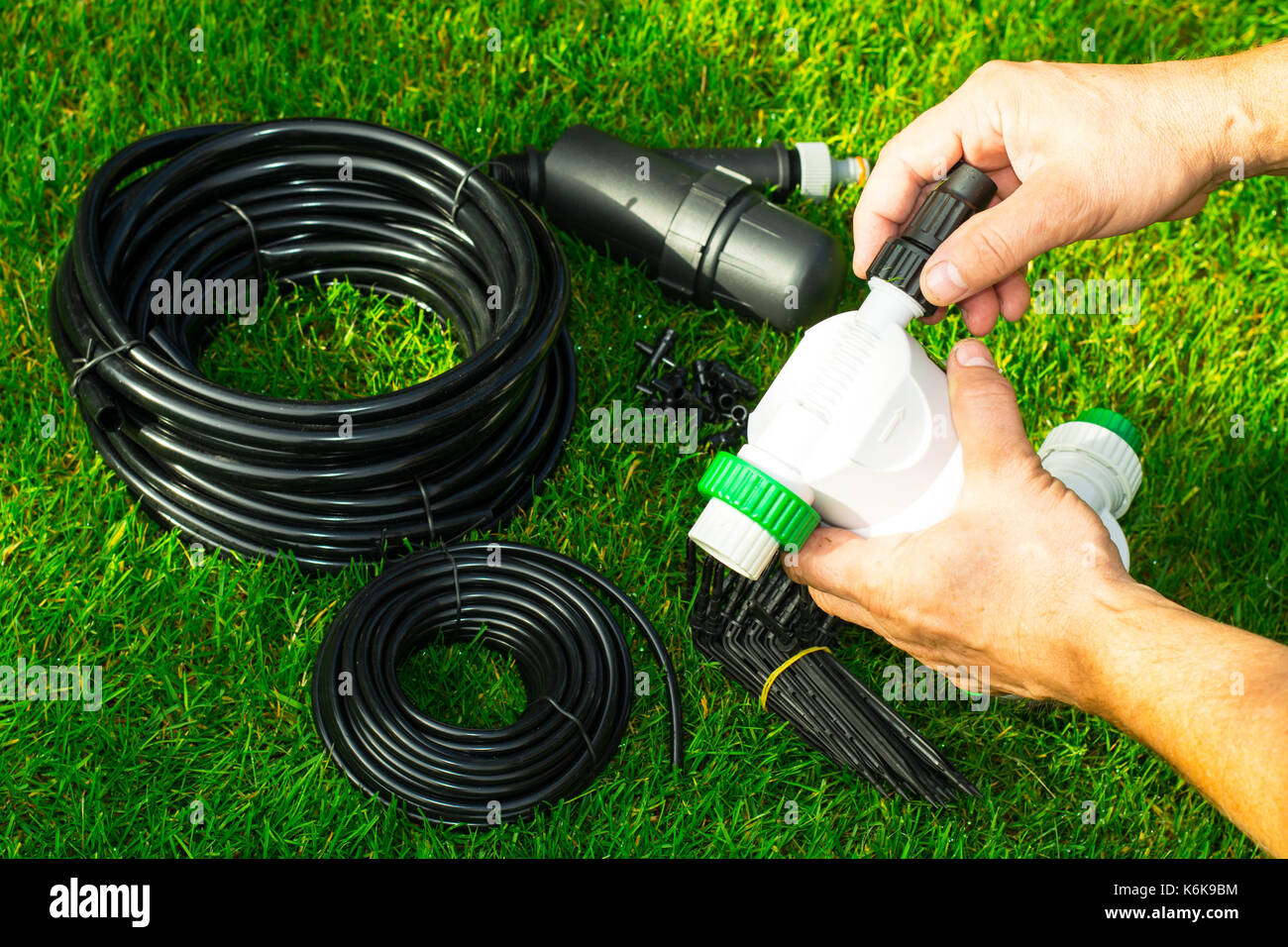 Automatic watering system for potted plants - Automatic Watering System For Plants In Beds Studio Photo Stock Image