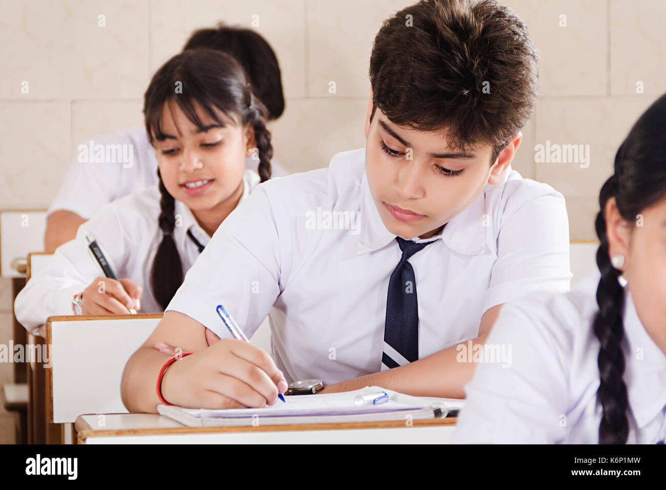 indian high school students notebook writing education in classroom