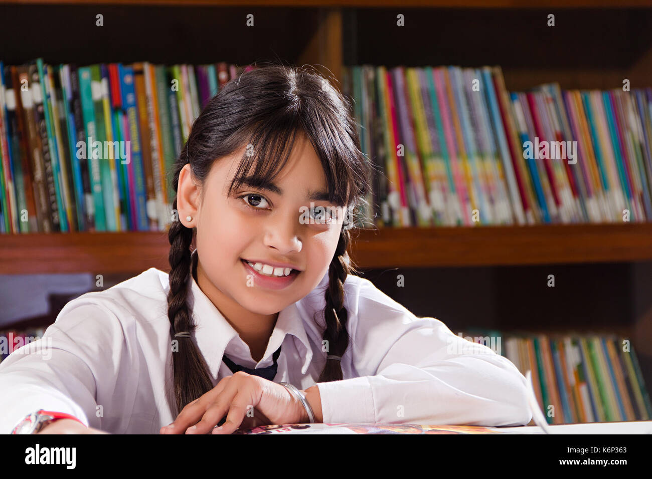 Indian Little Girl Studying Stock Photos & Indian Little