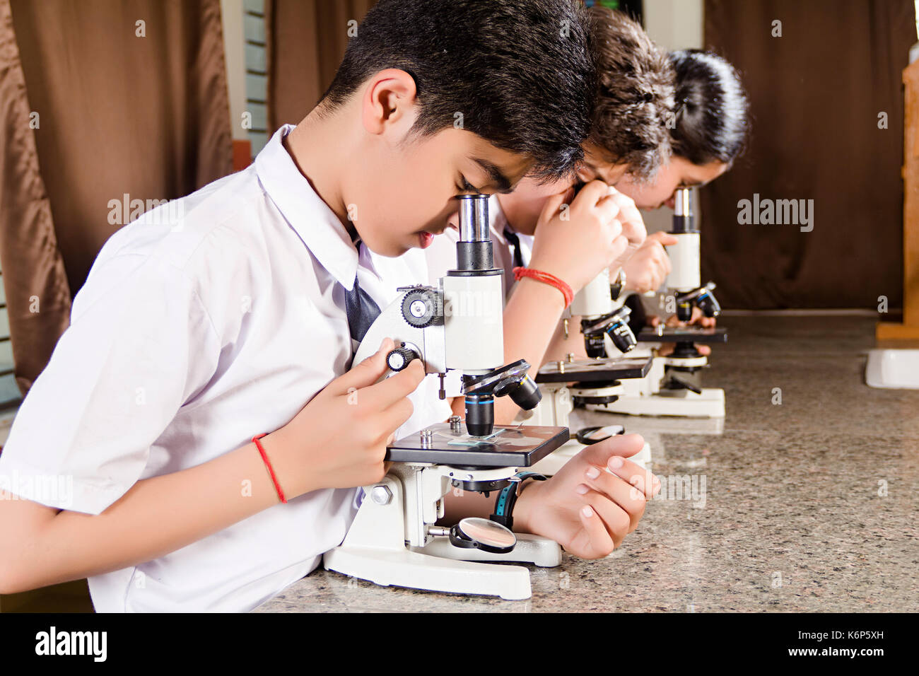 Indian School Students Checking Microscope Science Lab Research