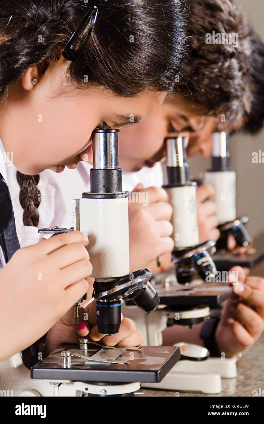 Indian School Students Checking Microscope Science Laboratory Stock
