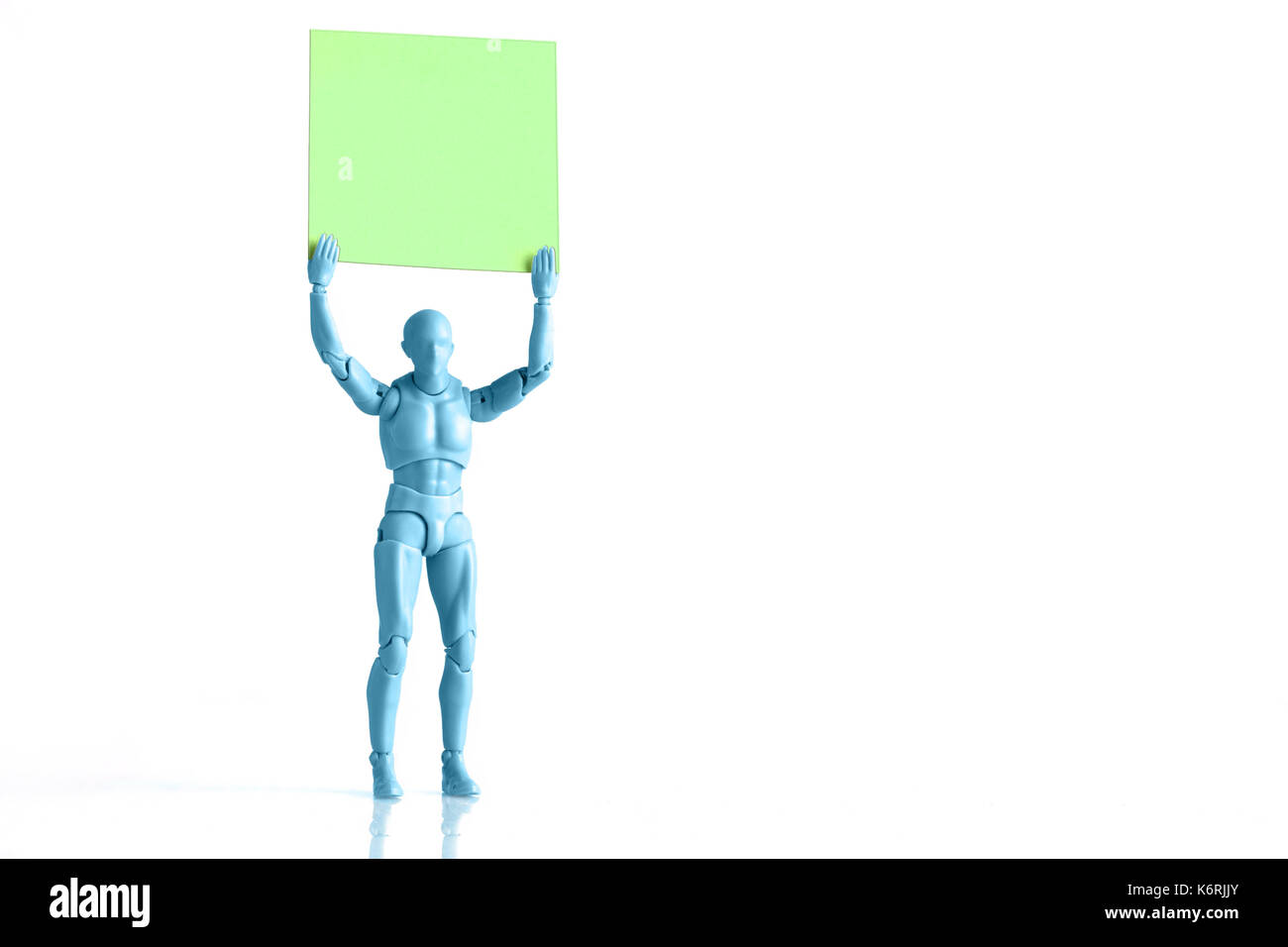 Blue male figurine holding up empty square piece of paper isolated blue male figurine holding up empty square piece of paper isolated on white with copy space buycottarizona Gallery