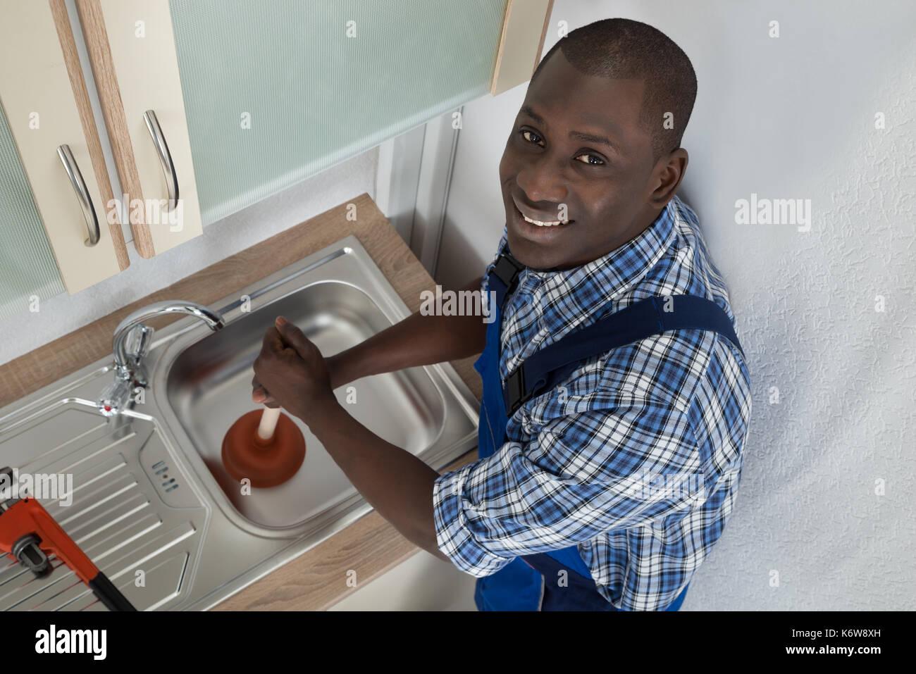 sink plunger stock photos sink plunger stock images alamy. Black Bedroom Furniture Sets. Home Design Ideas