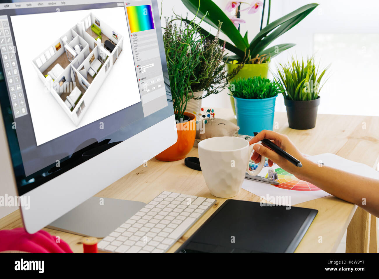 Graphic Designer Designing An Interior Home Using Pen Tablet. All Screen  Graphics Are Made Up.