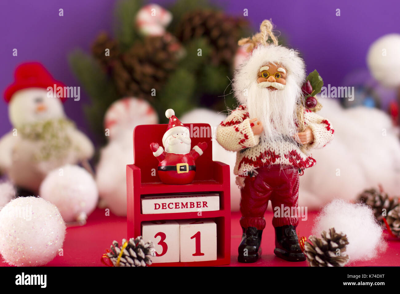 santa claus and new years calendar on december 31 on the background of a spruce wreath a snowman and christmas balls