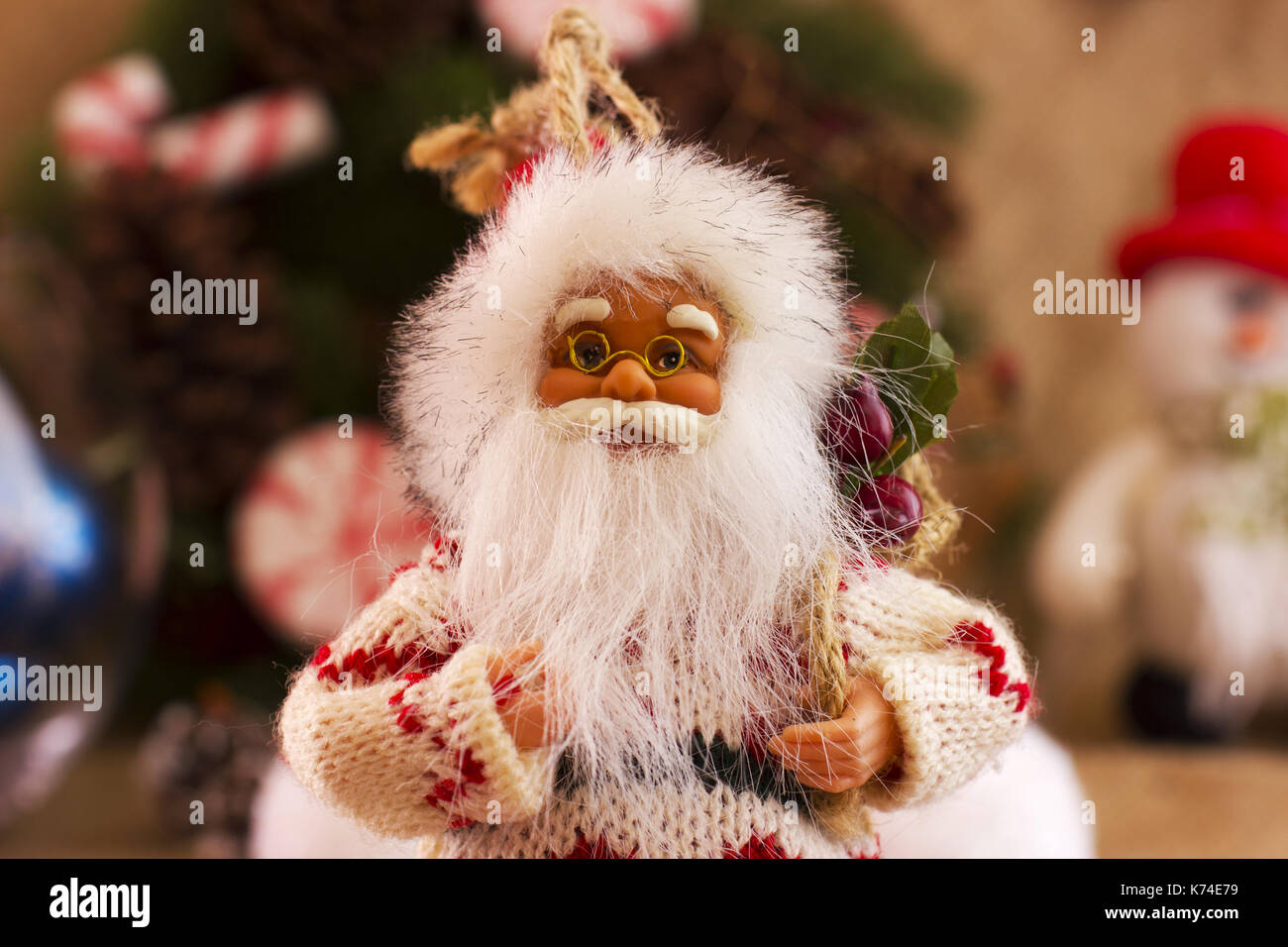 santa claus and new years calendar on december 31 on background of a spruce wreath a snowman and christmas balls