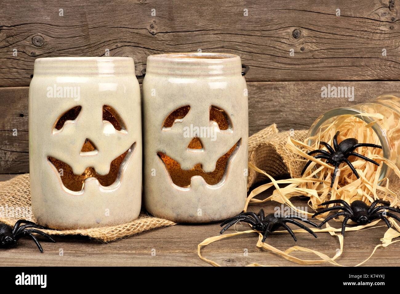 Rustic Mason Jar Jack O Lanterns With Of Spiders Against An Old Wood Background