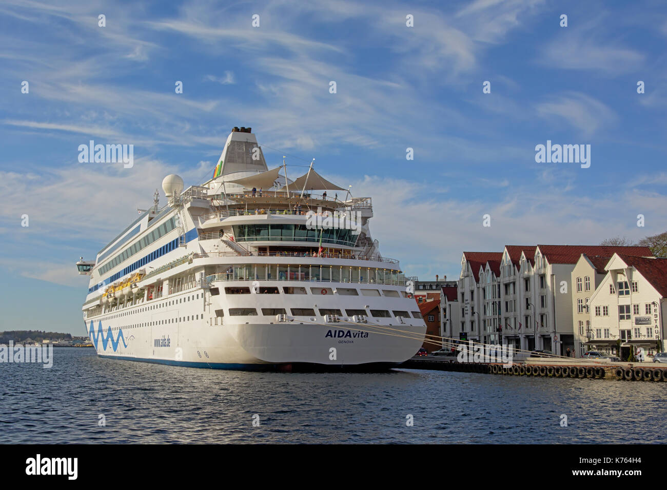 Cruise Ship Moored In Front Of Typical Traditional White Painted Wooden Houses Stavanger Norway