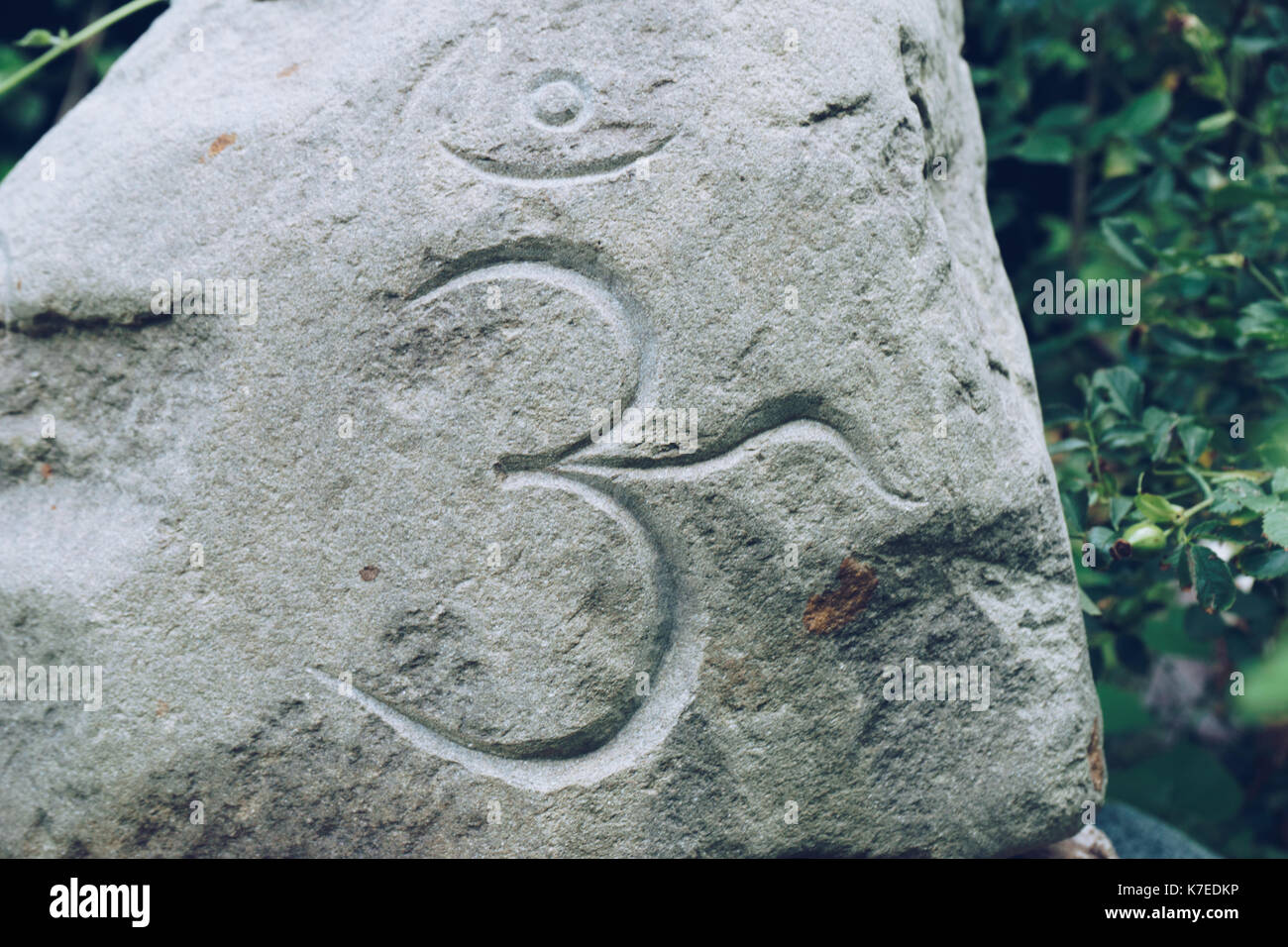 Om design stock photos om design stock images alamy om symbol writtng on a big stone stock image biocorpaavc Images