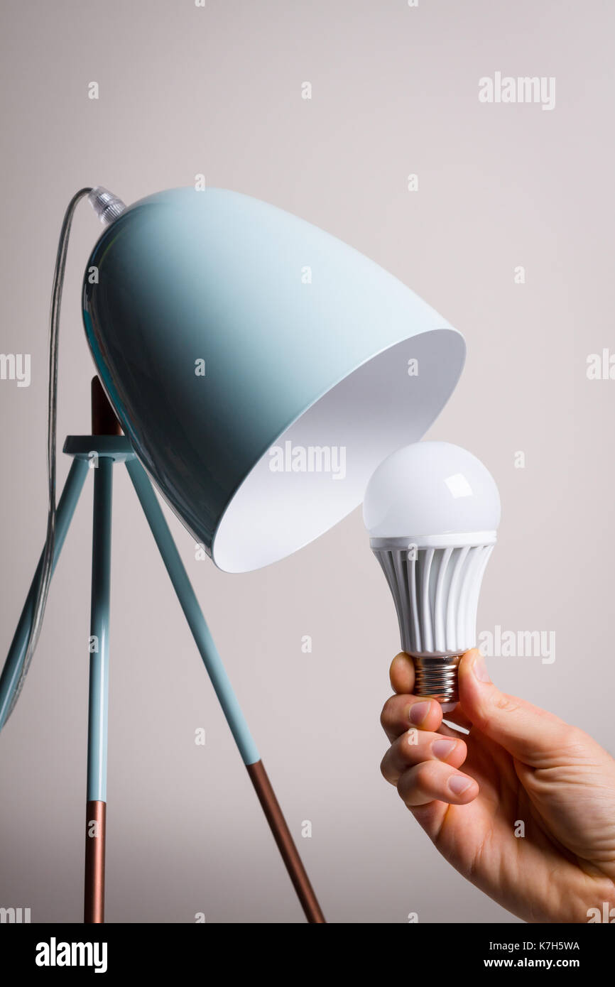 Changing the bulb for led bulb in table lamp in turquoise colours changing the bulb for led bulb in table lamp in turquoise colours geotapseo Image collections