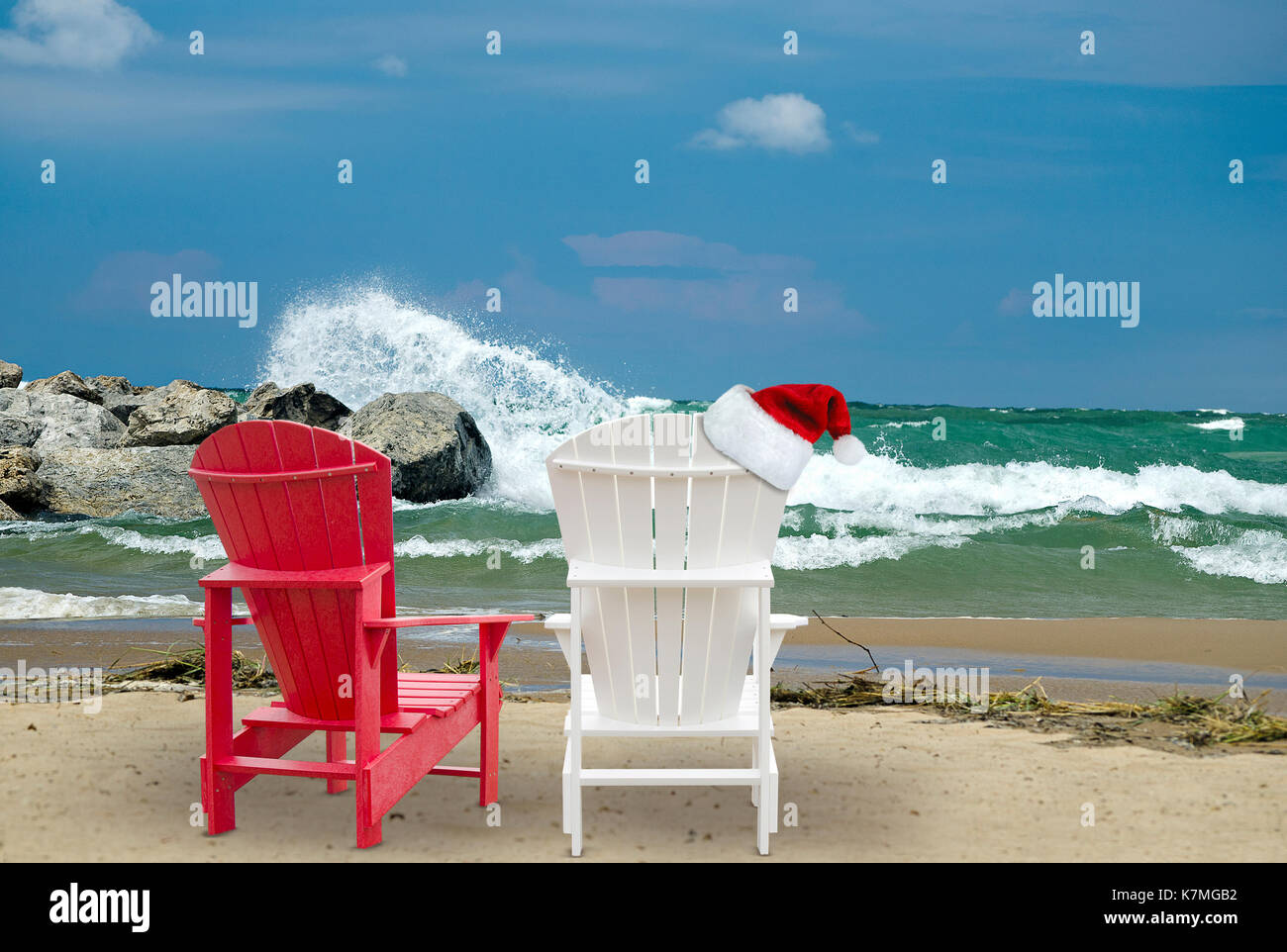 Adirondack Chairs On Beach With Christmas Hat