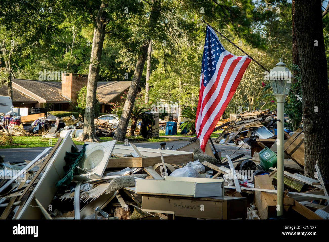 trash and debris out side of homes devastated by hurricane harvey